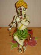 Lord Ganesha as Krishna playing Music